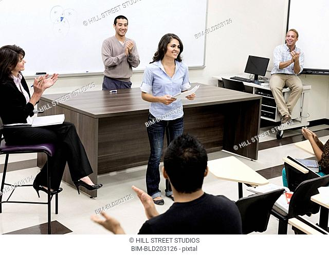 Student presenting paper to class