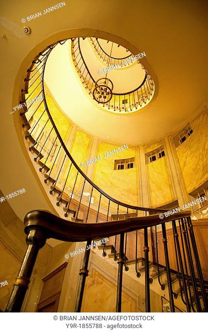 Circular staircase inside building near Bourse in Paris, Ile-de-France, France