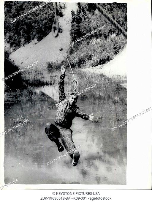 May 18, 1963 - Human to-tos learn the ropes.: In view of the trouble in South Vietnam, the United States have set-up a jungle training School in the hills of...
