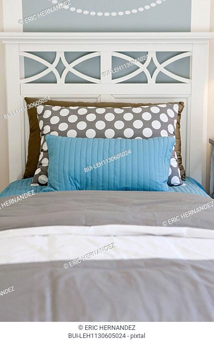 Pillows arranged on bed