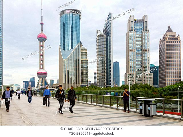 China, Shanghai. Oriental Pearl TV Tower, Office Buildings, and Pedestrians