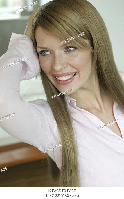 Side view of an ecstatic blonde woman