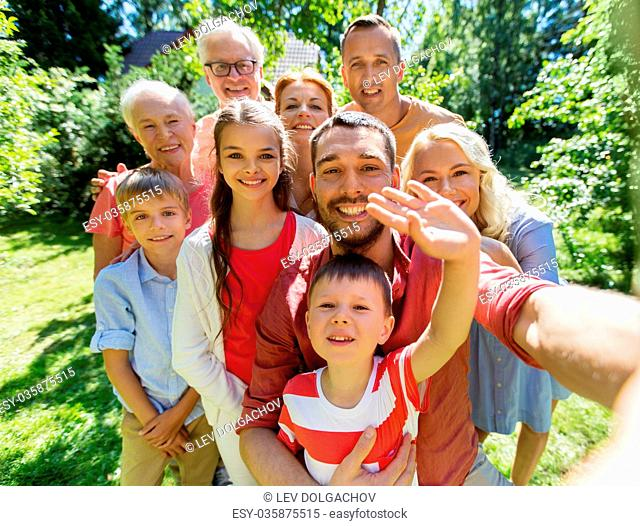 happy family taking selfie in summer garden
