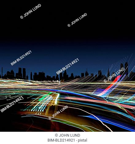 Light trails under New York City skyline at night, New York, United States