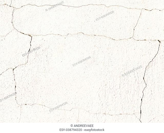 white old rough concrete painted wall with cracks on a rough surface