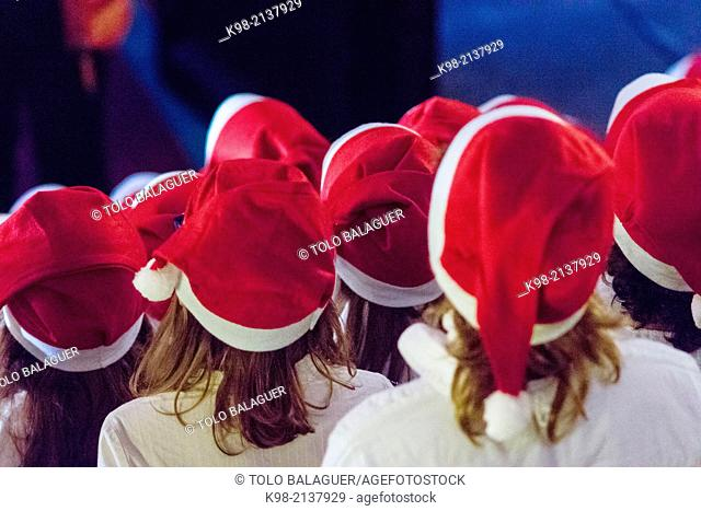 Children's choir in Santa's hats singing Christmas carols, Teatre Principal de Palma, Palau Reial, Palma, Majorca, Balearic Islands, Spain