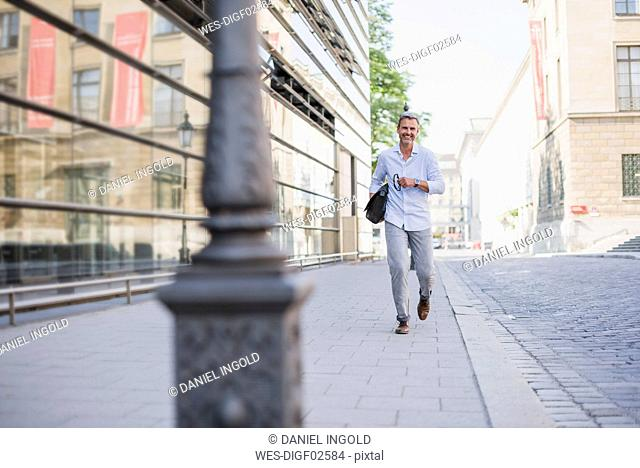 Smiling man walking in the city