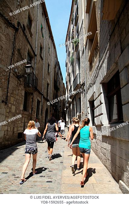 Tourists walking along the Carrer de Forca, Girona. Catalonia. Spain