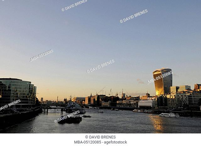View from Tower Bridge along the River Thames and HMS Belfast and City of London including The Walkie Talkie Building to right, London, England