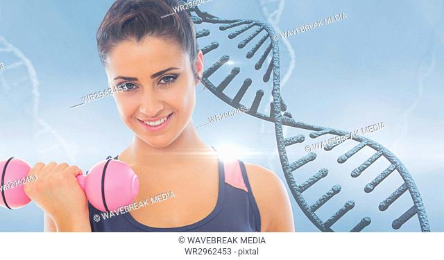 Woman lifting dumbbell against DNA structure