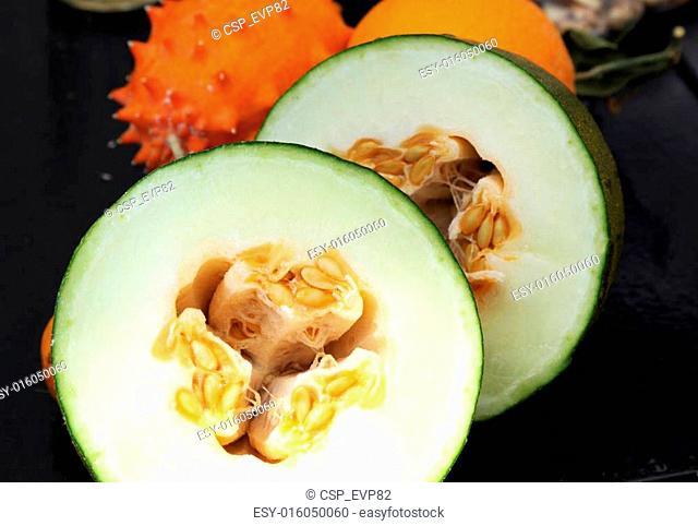 Exotic fruits: melon, kiwano and orange