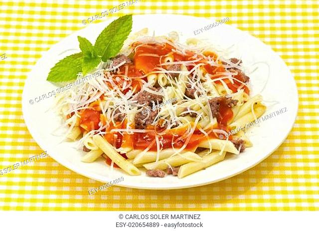 Traditional macaroni pasta with tomato grated cheese