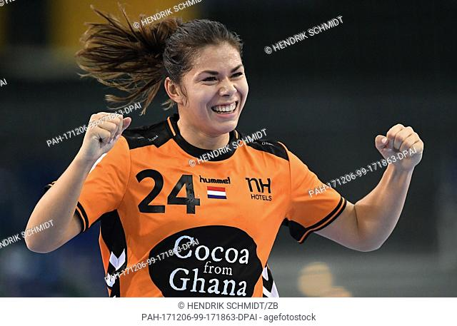 Netherland's Martine Smeets celebrates her goal during the group match of the World Women's Handball Championship between Serbia and Netherlands at the Arena in...