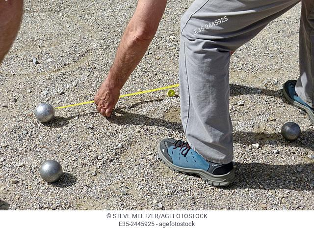 In a petanque competition judges determine within a centimeter which ball is closest to the target ball