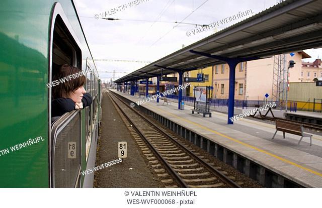 Czechoslovakia, Young woman looking through train window