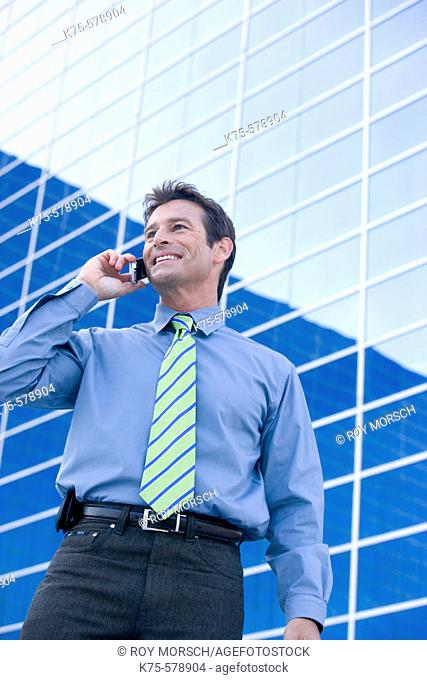 Man on cell phone outside modern building
