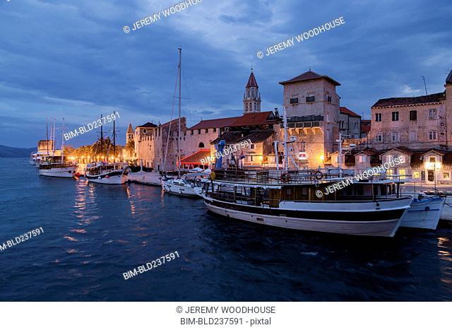Boats at waterfront at dawn, Trogir, Dalmatia, Croatia