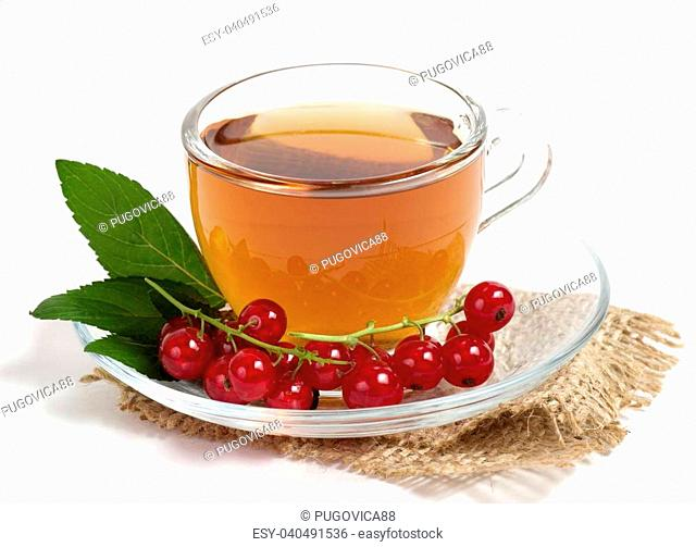 Fruit tea in cup with red currant