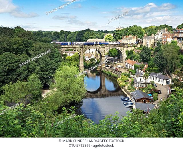 Northern Train Crossing the Railway Viaduct over the River Nidd at Knaresborough North Yorkshire England
