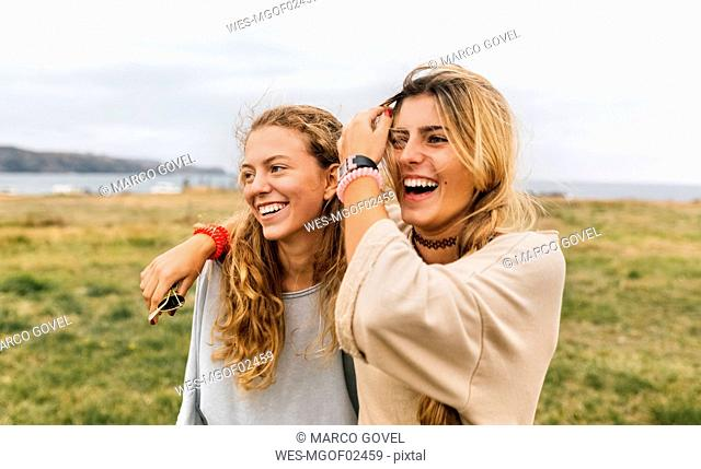 Two happy teenage girls near the coast