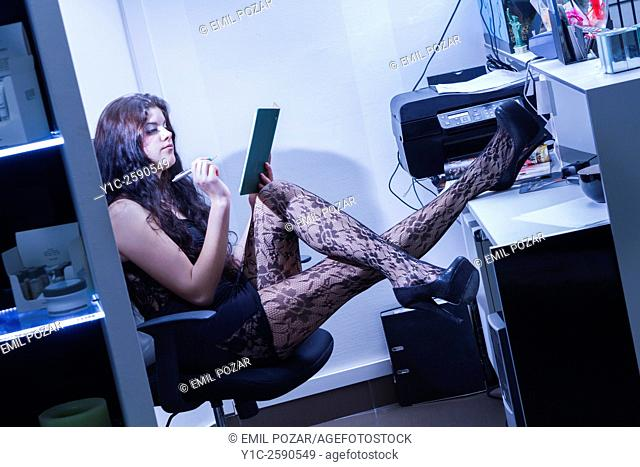 Young secretary legs on desk making schedules