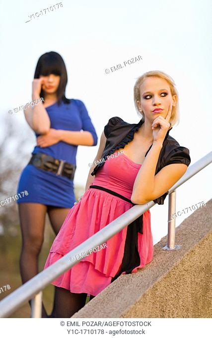 Two young women are contemplating