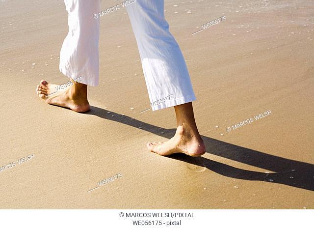 Detail of Feet Walking on the Sea Shore