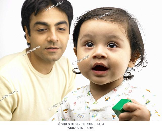 Indian father behind baby girl MR702O,702A