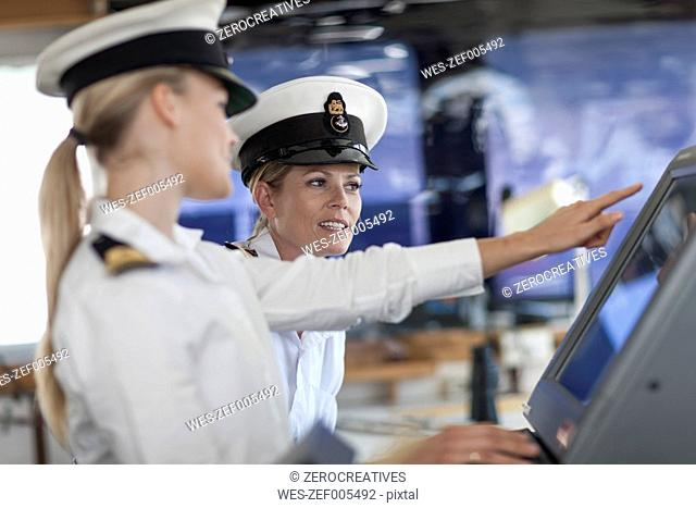 Two female deck officers on bridge