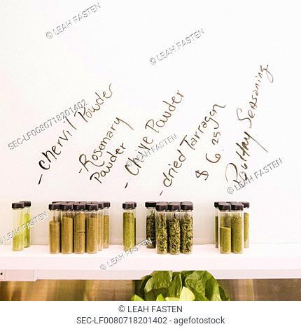 Vials with seasonings on shelf