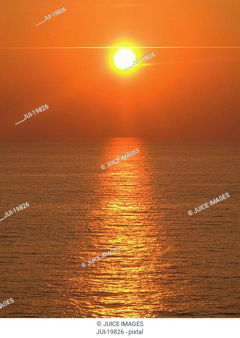 Sunset over tranquil sea