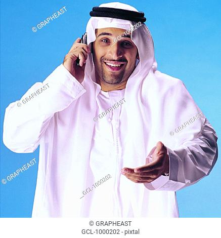 Arab businessman arguing on cell phone