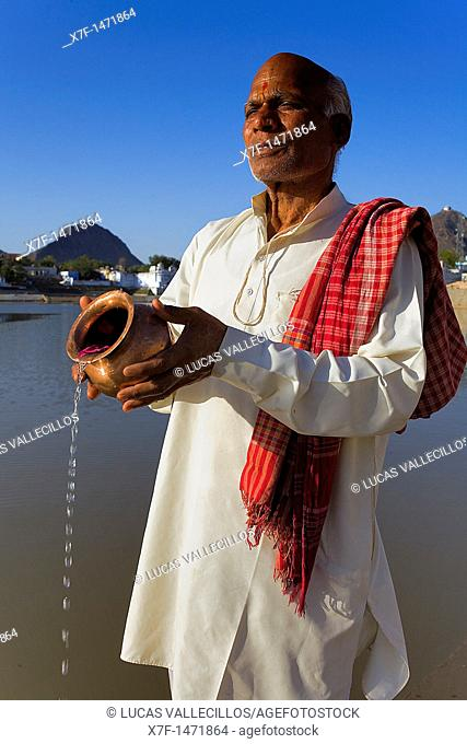 Sadhu praying at the holy lake,pushkar, Rajasthan, india