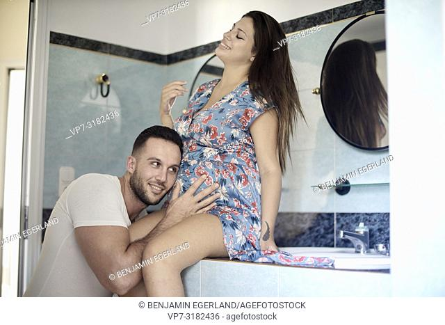young couple in bathroom, pregnancy