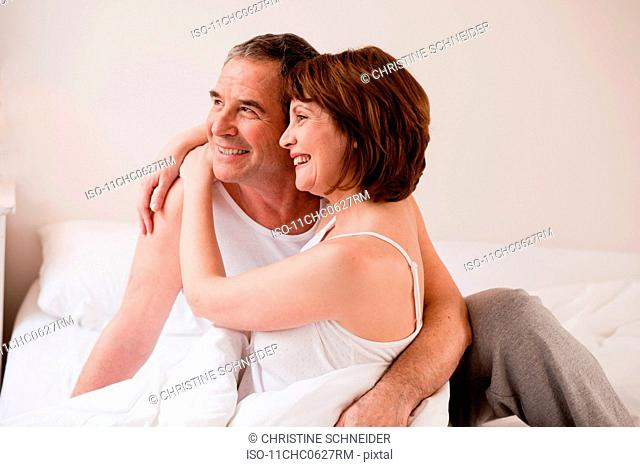 Eldery couple embracing and smiling