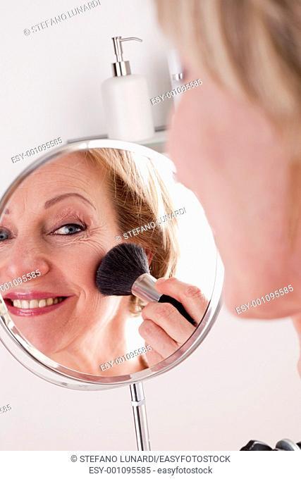 Mature Woman Making Up