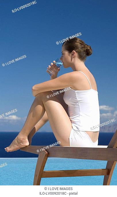 A woman relaxing by a pool
