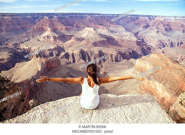 USA, Arizona, young woman enjoying the view at Grand Canyon, back view
