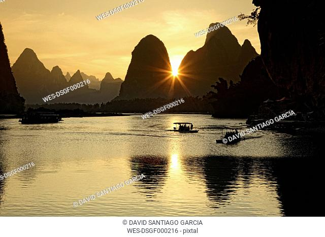 China, Guangxi, boats to transport tourists on Li river near Guilin