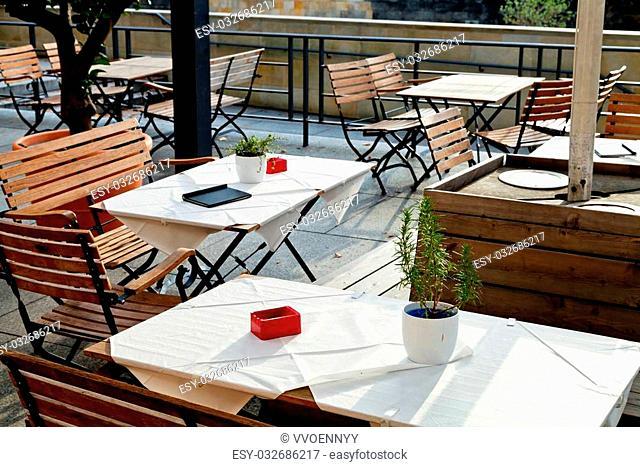 empty outdoor tables of waterfront restaurant in Berlin in autumn