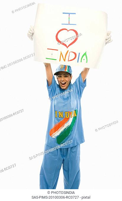 Woman in cricket uniform holding a placard with text I Love India written on it