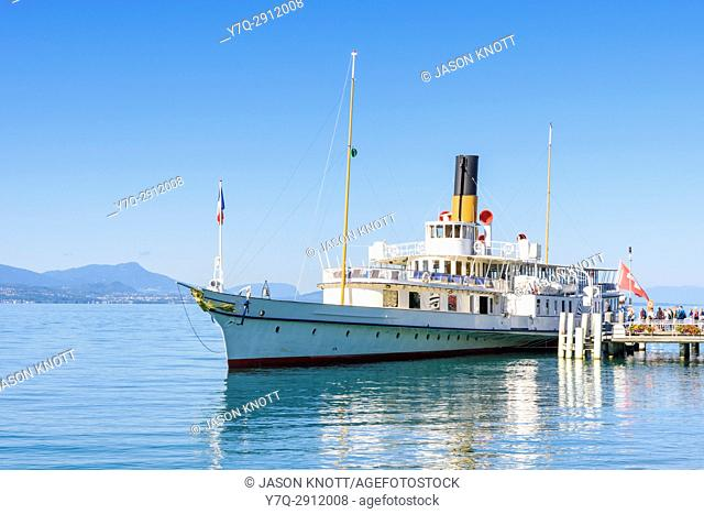 The Belle Epoque paddle steamer La Suisse moored in Ouchy with passengers boarding, Lausanne, Vaud, Switzerland