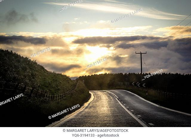 Scottish landscape on the road at the sunset