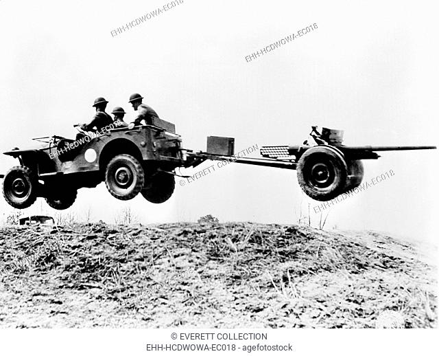 The new 'jeep' in mid-air as it pulls a small artillery piece ca. 1941