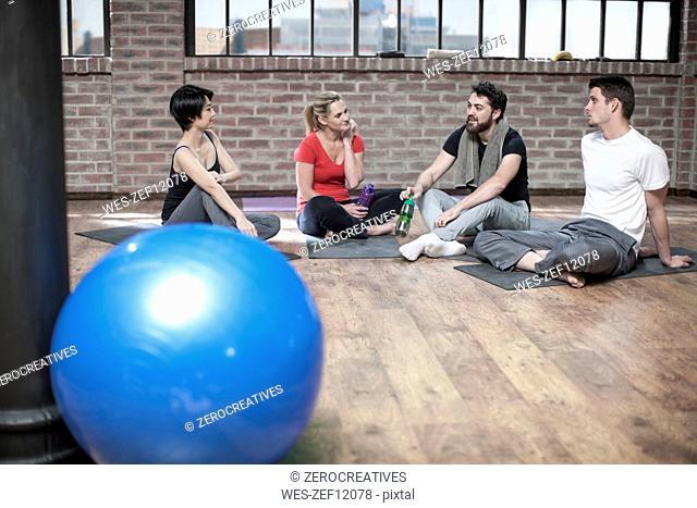 Group of people in yoga class studio