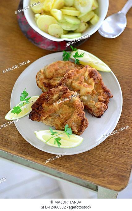Wiener Schnitzel with potato and cucumber salad