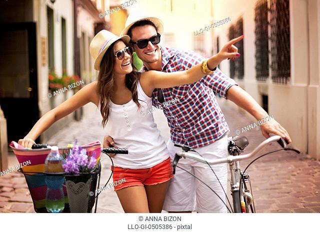 Happy couple with bikes, the city, Debica, Poland