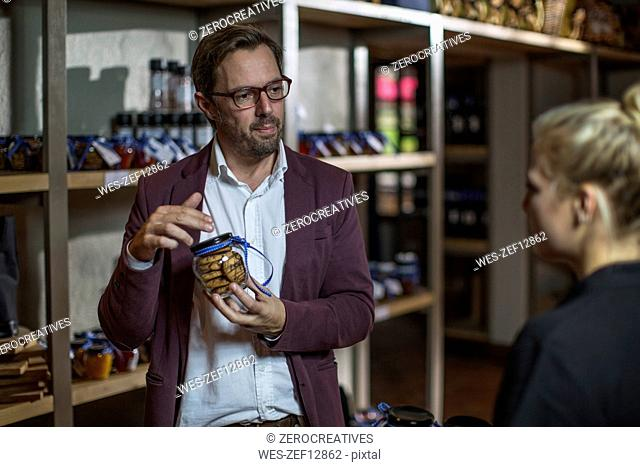 Man choosing biscuits at shop