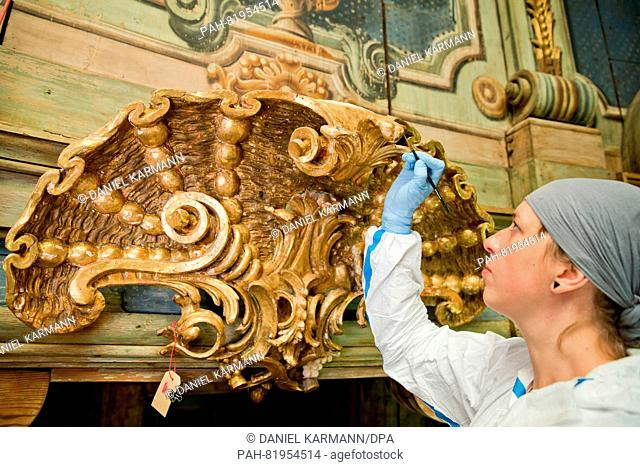 Conservator-restorer Anja Eichler pictured during restoration work on the Margravial Opera House in Bayreuth, Germany, 24 May 2016