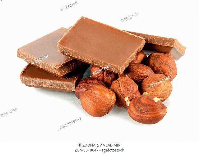 The pile of milk chocolate blocks isolated